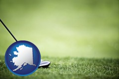alaska map icon and a golf ball and a golf club on a golf course