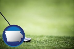 iowa map icon and a golf ball and a golf club on a golf course