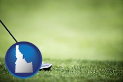idaho map icon and a golf ball and a golf club on a golf course