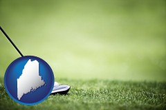 maine map icon and a golf ball and a golf club on a golf course