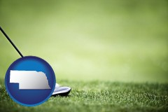 nebraska map icon and a golf ball and a golf club on a golf course