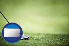 pennsylvania map icon and a golf ball and a golf club on a golf course