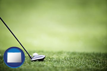 a golf ball and a golf club on a golf course - with Colorado icon