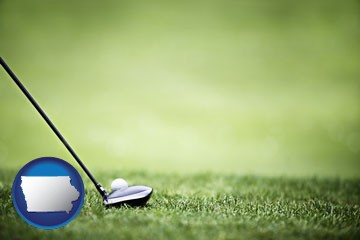 a golf ball and a golf club on a golf course - with Iowa icon