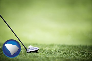 a golf ball and a golf club on a golf course - with South Carolina icon